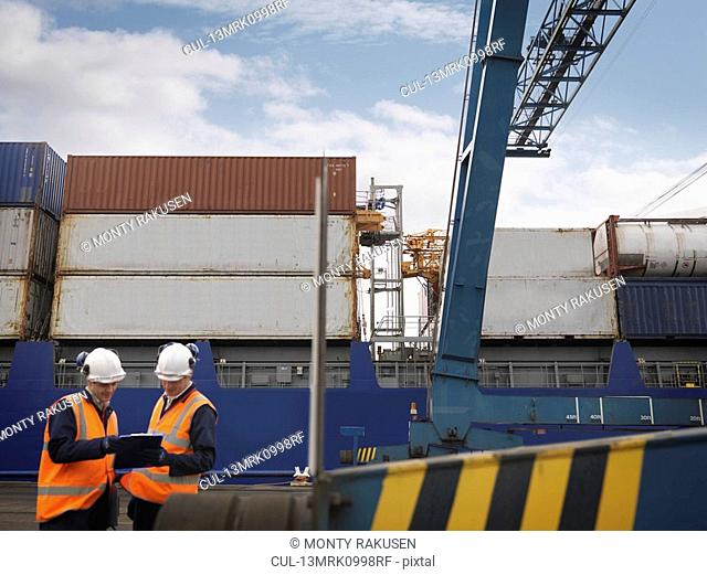 Port Workers In Front Of Loaded Ship