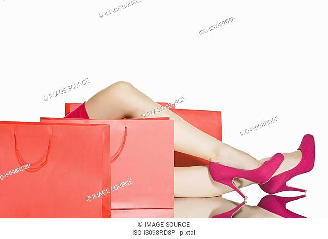 Shoes of woman and shopping bags