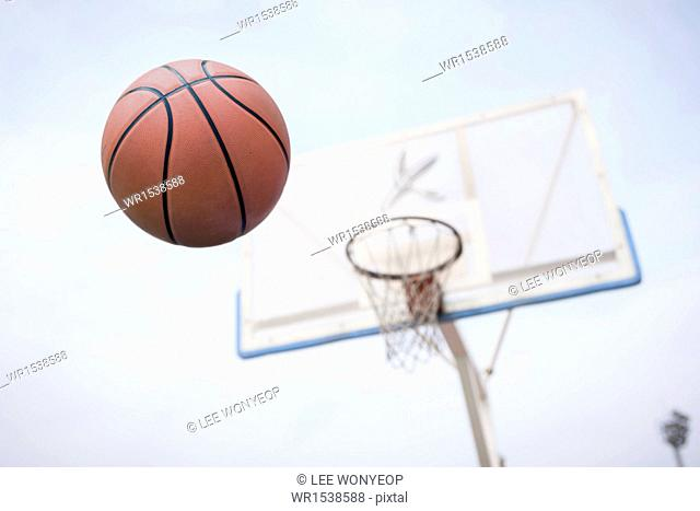 a basketball going in to the basket