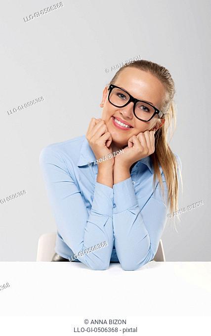 Portrait of cute sitting blond businesswoman, Debica, Poland
