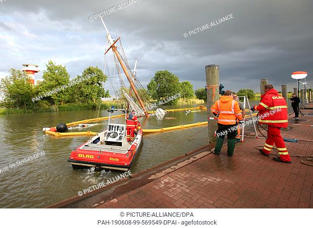 "08 June 2019, Lower Saxony, Stadersand: The sunken historic sailing ship """"No 5 Elbe"""" is almost completely under water in the harbour of Stadersand"