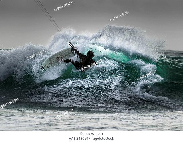 Kitesurfer on a large wave; Tarifa, Cadiz, Andalusia, Spain