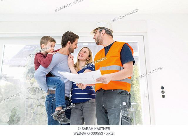 Construction worker showing family construcion plan