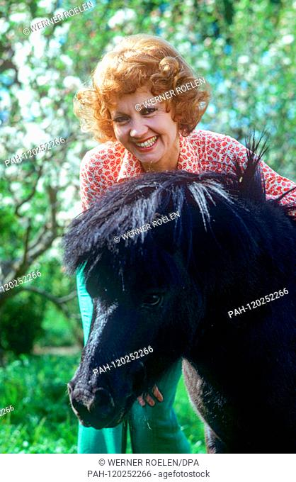Lilo Pulver in the 1970s near her home in Lausanne with a pony. Swiss actress Lilo Pulver was born on 11 October 1929 in Bern. | usage worldwide