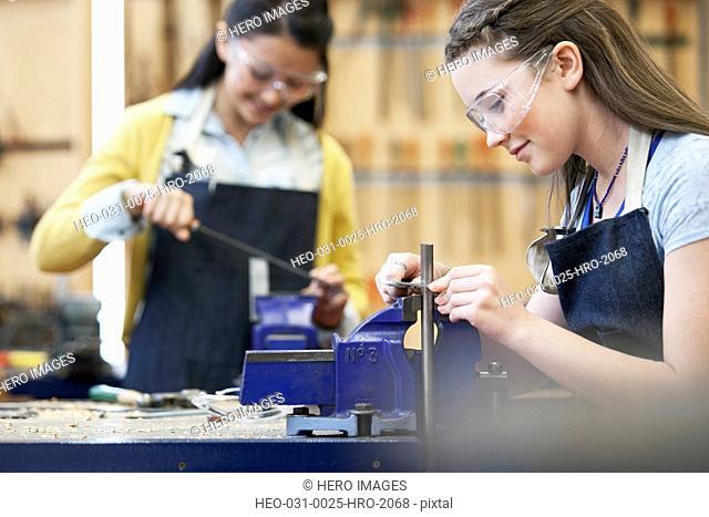 female students in machine shop class