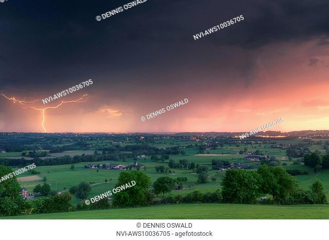 Cloud-to-ground lightning at sunset near Liège, Belgium