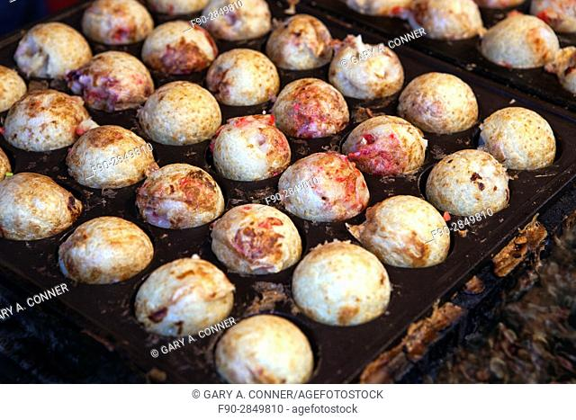Takoyaki, grilled minced octopus and pickled ginger, sold at festival in Tokyo, Japan