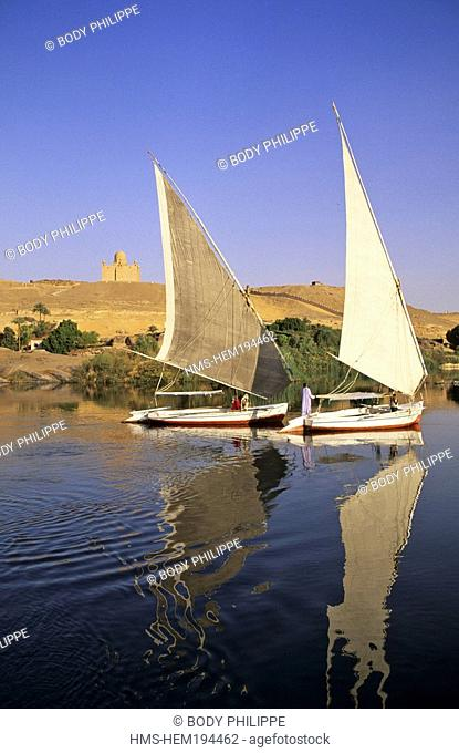 Egypt, Upper Egypt, Aswan, feluccas on Nile River, Aga Khan Mausoleum in the background