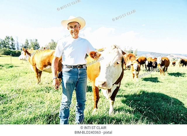Caucasian farmer petting cow