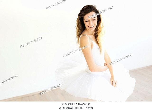 Portrait of a smiling ballet dancer in a tutu
