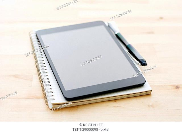 Studio shot of digital tablet, Spiral notebook and ballpoint pen
