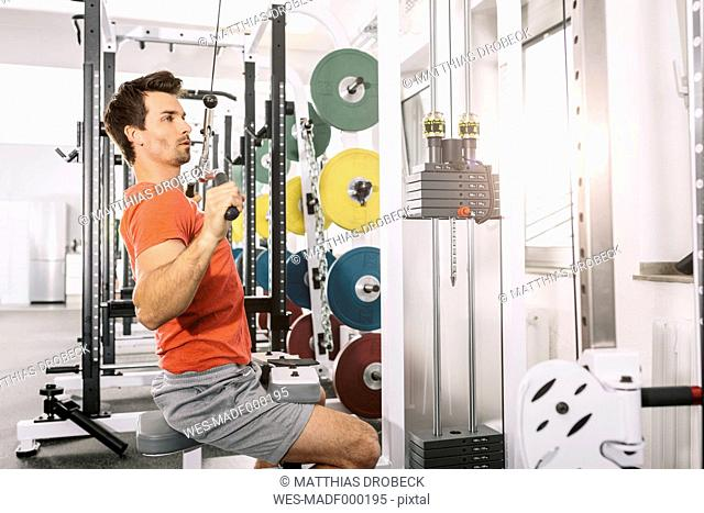 Young man training at gym