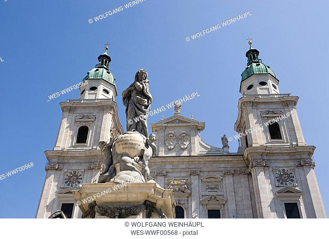 Austria, Salzburg Cathedral and statue of the Virgin Mary, low angle view