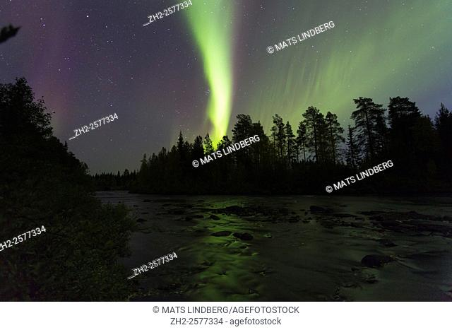 Northern light, Aurora borealis, reflecting in a river, Gällivare, Swedish Lapland, Sweden