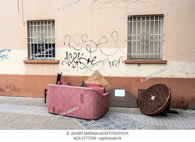 Furniture abandoned on the sidewalk, Valencia, Spain