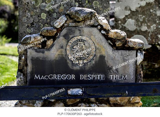Headstone with epitaph MacGregor Despite Them on the grave of Rob Roy MacGregor at the Balquhidder kirkyard, Stirling, Scotland, UK