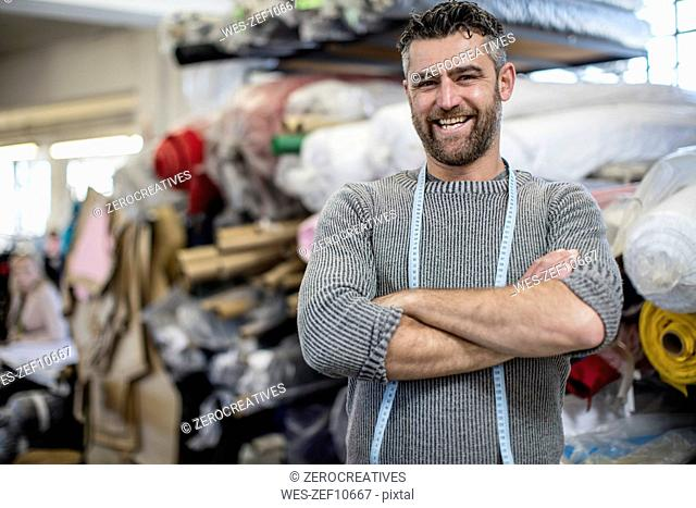 Portrait of confident tailor in workshop