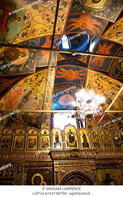 Russia, Moscow Oblast, Moscow. A view of ornate ceiling detail at St Basils Cathedral in Red Square