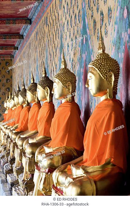 Seated Buddha statues in a row at Wat Pho (Wat Phra Chetuphon) (Temple of the Reclining Buddha), Bangkok, Thailand, Southeast Asia, Asia
