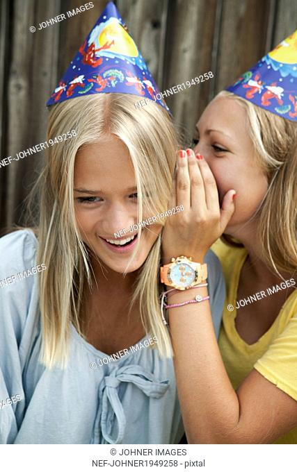 Teenage girls whispering, Sweden