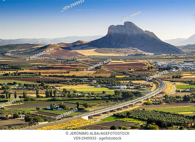 Panoramic view. La Peña de los Enamorados, Lovers Rock or Montaña del Indio & High Speed Train Line AVE, Antequera. Málaga province, Andalusia