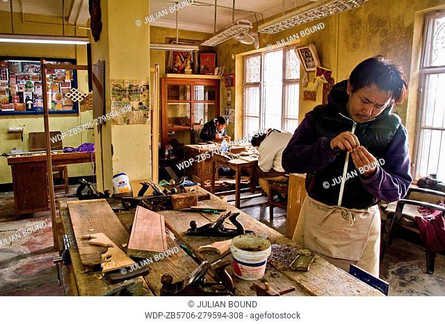 Wood workshop and Tibetan craftsman of Norbulingka Institute of Tibetan Arts, Dharamshala, India