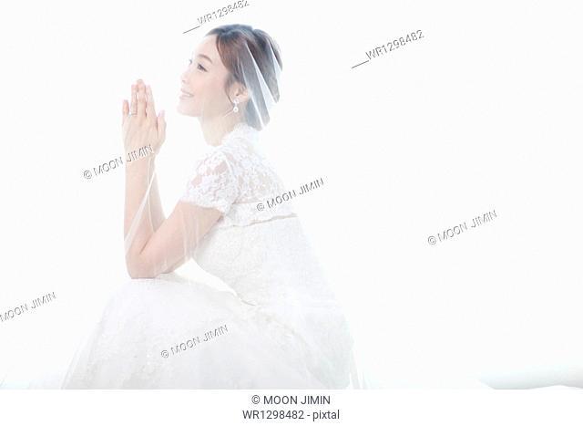 side shot of a woman in wedding dress