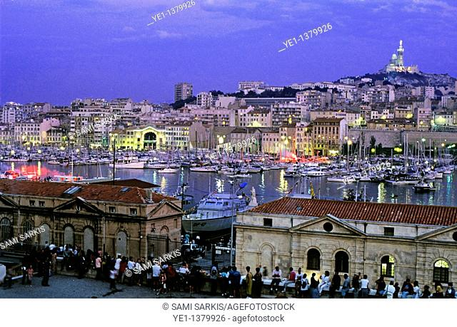 Boats in the marina of the Vieux-Port with Notre Dame de la Garde in the background, Marseille, France