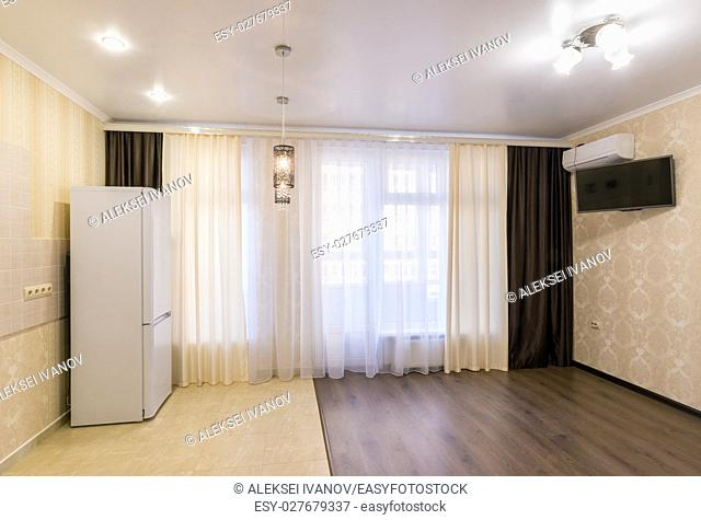The interior of a small room studio renovated unfurnished