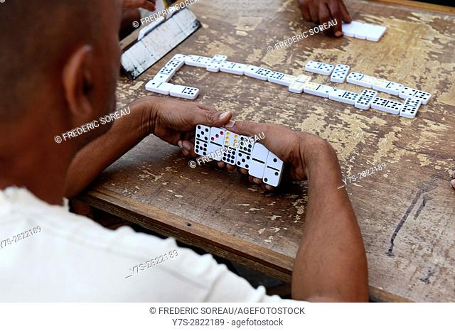 Men playing dominos in a street of Remedios, Cuba