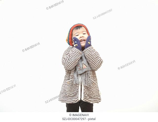 A girl wearing in winter clothes