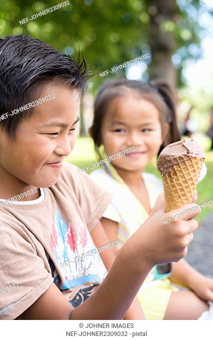 Brother and sister eating ice-cream