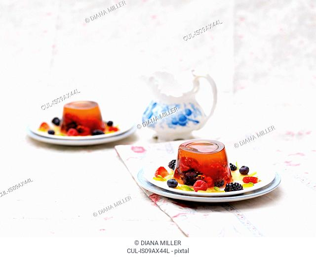 Fruit jelly dessert with fresh fruit, on plate