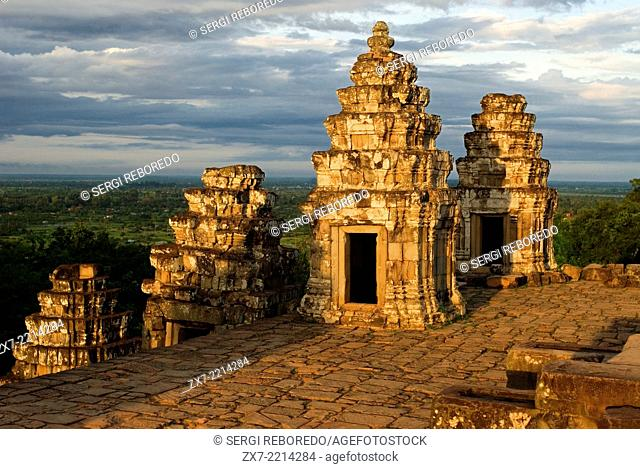 Phnom Bakheng Temple. Sunrise. Phnom Bakheng is located 1,30 meters (4,265 feet) north of Angkor Wat and 400 meters (1,312 feet) south of Angkor Thom