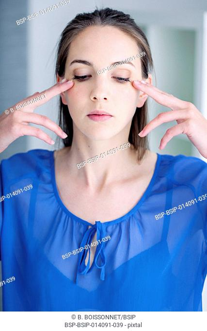Woman doing face gym