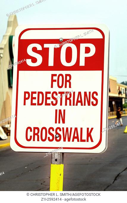 Stop for Pedestrians Sign in a parking lot
