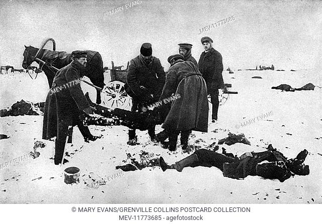 Revolution victims and a burial squad at work during a period of Bolshevik-led anarchy in Russia, with snow on the ground