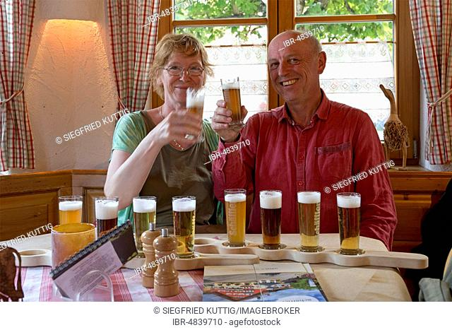 Couple at the beer tasting, Brauereigasthof Schäffler, Missen-Wilhams, Allgäu, Bavaria, Germany