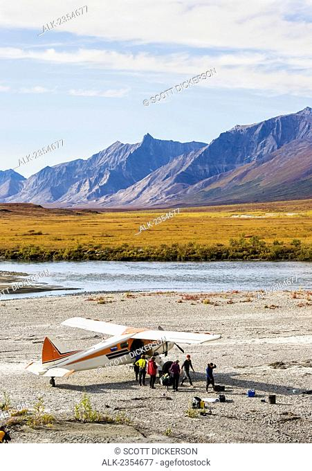 Bushplane picks up passengers after a river rafting trip in Gates of the Arctic National Park; Alaska, United States of America