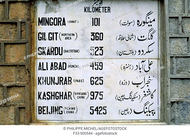 Distance information board, Karakoram Highway (paved international road that connects China and Pakistan). North-West Frontiere Province (NWFP), Pakistan