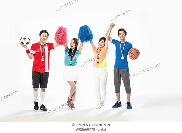 Young smiling Korean sports players cheering