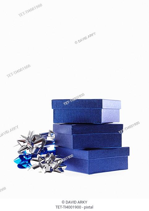 Stack of blue boxes with ribbons, studio shot