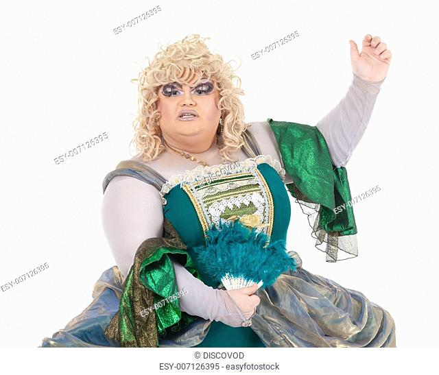 Overweight drag queen in vintage dress and pretty curly blond wig accentuating his weight with Victorian bustles in a fun caricature of a period woman, on white