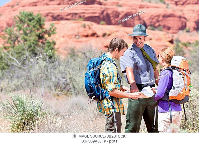 Hikers talking to park ranger