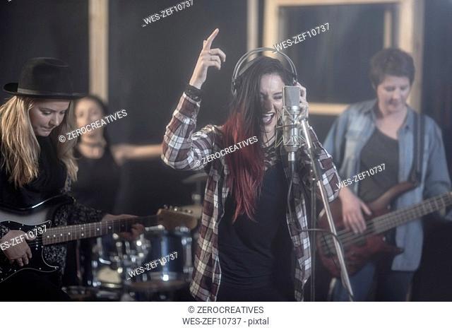 Female rock band in recording studio