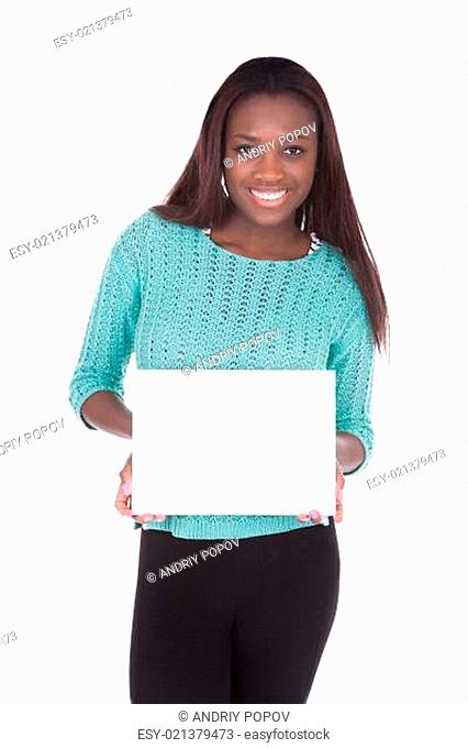 Woman holding blank placard against white background