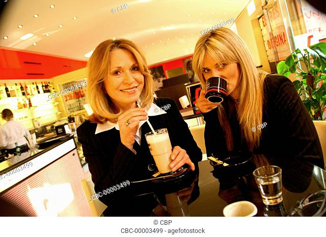 Two Blond Women Sitting in a Cafe