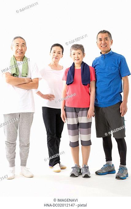 Four senior men and women enjoying sports