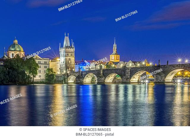Charles Bridge and city illuminated at night, Prague, Czech Republic