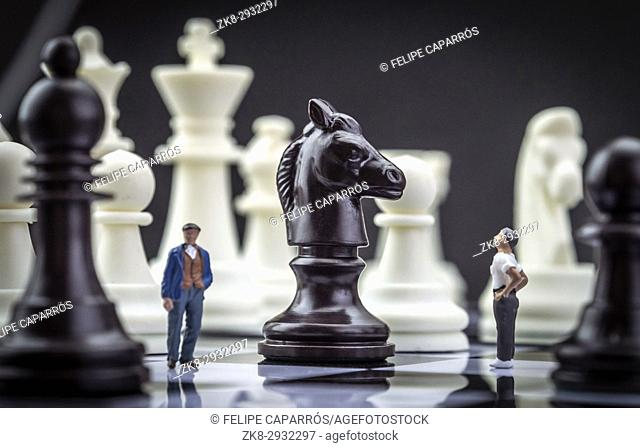 Men thumbnail within a game of chess, concept